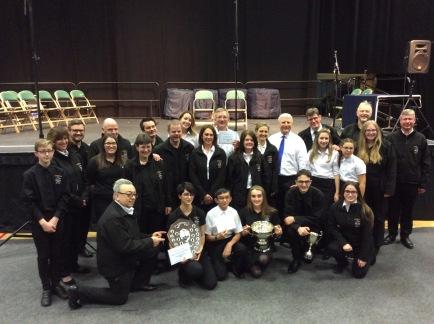 Band celebrating a fantastic achievement